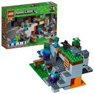 Contiene una escena de una cueva Minecraft para construir con función de explosión de TNT, escalera, horno y lava, así como elementos que representan carbón, piedra roja, oro y diamantes.